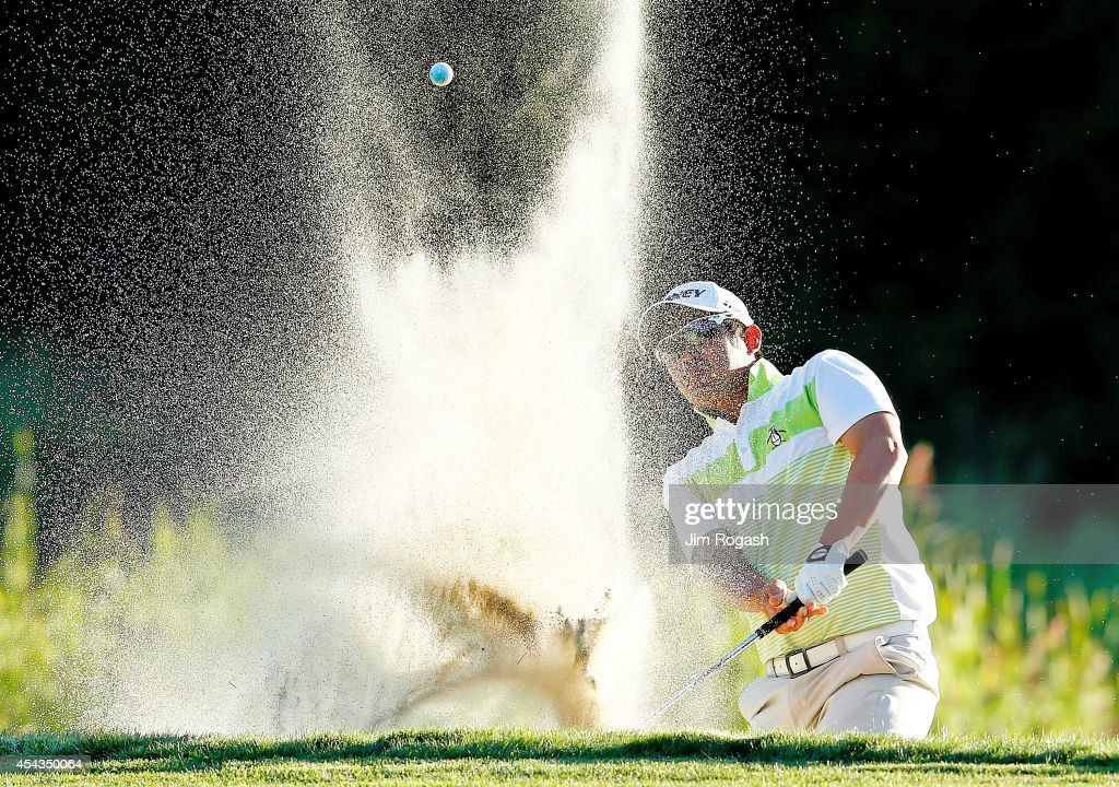 John Huh hits his shot out of the bunker on the eighth hole during the first round of the Deutsche Bank Championship at the TPC Boston on August 29...