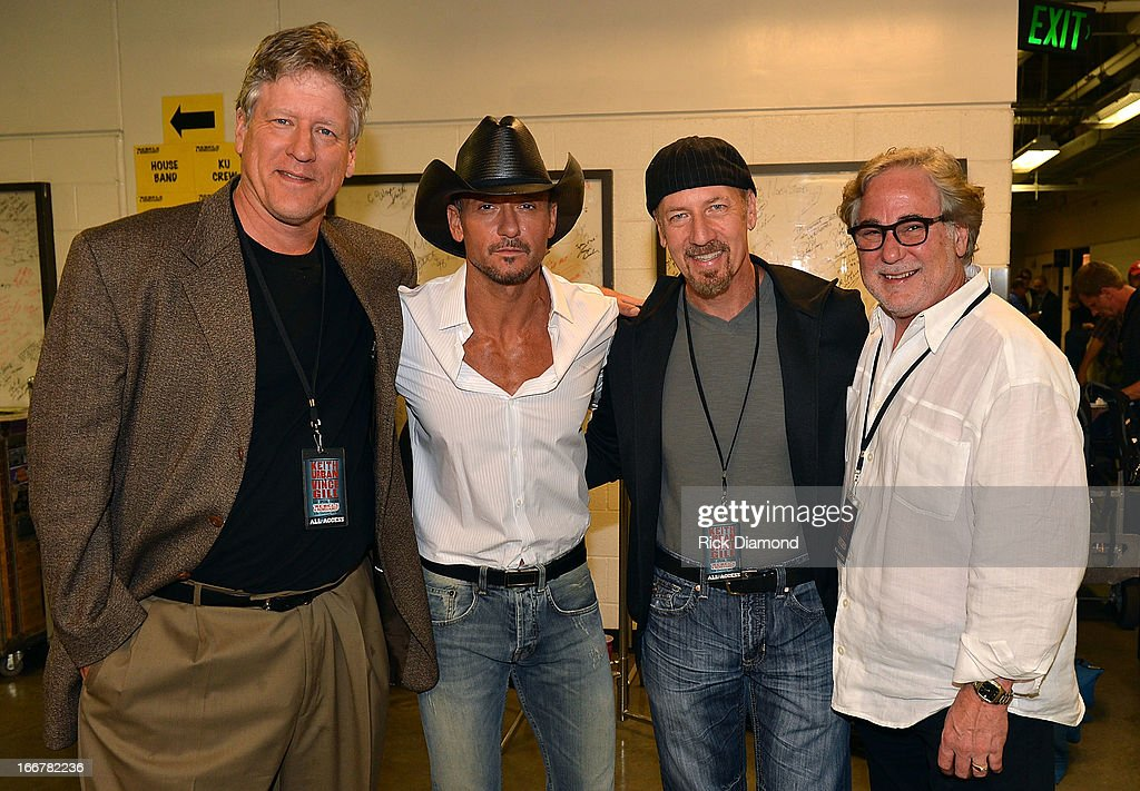 John Huie CAA, Tim McGraw, Guest, and Rod Essig CAA backstage during Keith Urban's Fourth annual We're All For The Hall benefit concert at Bridgestone Arena on April 16, 2013 in Nashville, Tennessee.