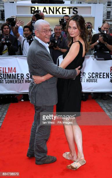 John Hurt and Anna Walton arrive at the opening night gala screening of Hellboy IIThe Golden Army which kicks off the annual film season FilmFour...