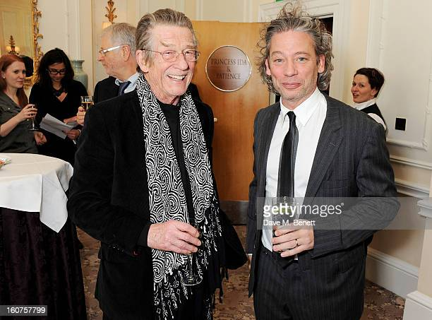 John Hurt and Dexter Fletcher attends a drinks reception awarding Sir Alan Parker the BAFTA Fellowship supported by Hackett at The Savoy Hotel on...