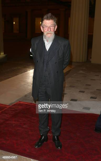 John Hurt attends a Dramatic Arts Reception at Buckingham Palace on February 17 2014 in London England