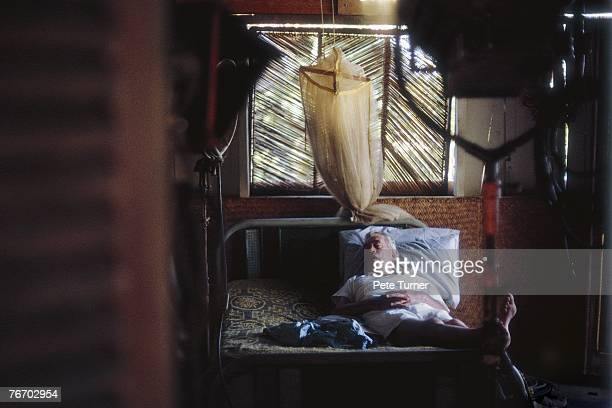 John Huston takes a nap on the set of 'The Night Of The Iguana' on location in Puerto Vallarta Mexion in February 1963 Directed by John Huston