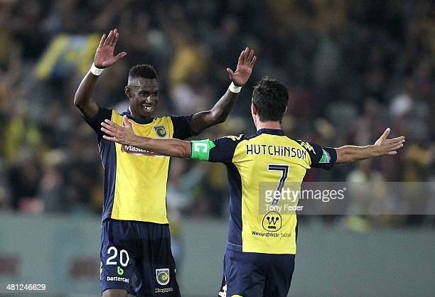 John Hutchinson and Bernie Ibini of the Mariners celebrate the win over the Wanderers during the round 25 ALeague match between the Central Coast...