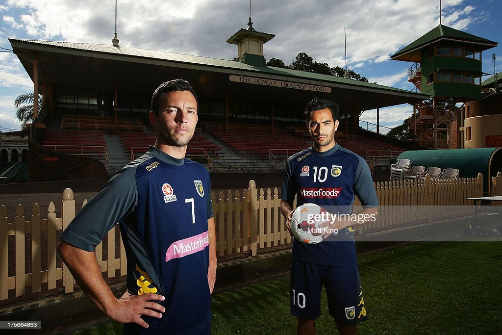 John Hutchinson (L) and Marcos Flores (R) pose during a Central Coast Mariners A-League media announcement at North Sydney Oval on August 6, 2013 in Sydney, Australia.