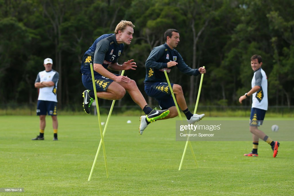 John Hutchinson (R) and Zachary Anderson of the Mariners warm up during a Central Coast Mariners A-League training session at Central Coast Mariners Centre of Excellence on April 17, 2013 in Tuggerah, Australia.