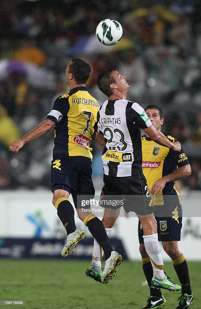 John Hutchinson of the Central Coast and Ryan Griffiths of Newcastle contest a header during the round 17 ALeague match between the Central Coast...