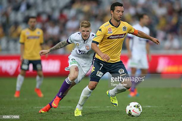 John Hutchinson of the Mariners controls the ball in front of Damian Keogh of the Glory during the round five ALeague match between the Central Coast...