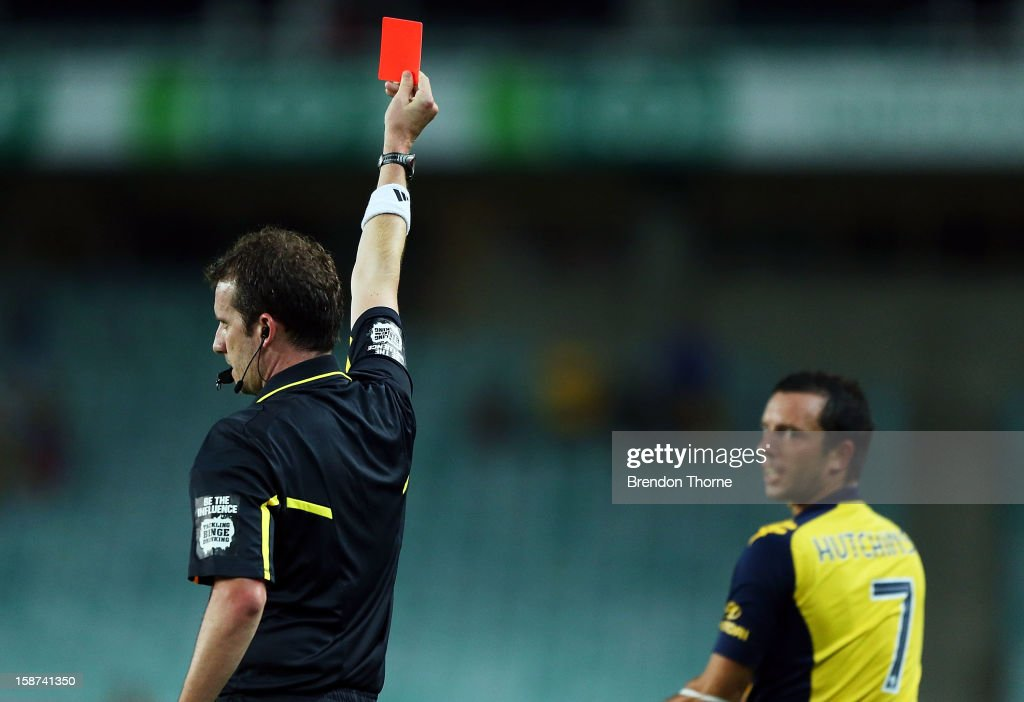 John Hutchinson of the Mariners receives a red card from referee Peter Green during the round 13 A-League match between Sydney FC and the Central Coast Mariners at Allianz Stadium on December 27, 2012 in Sydney, Australia.