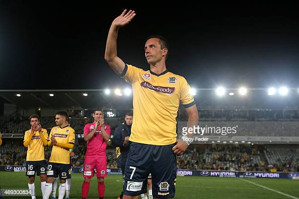 John Hutchinson waves to the crowd after playing his last game at Central Coast Stadium for the Mariners during the round 25 ALeague match between...