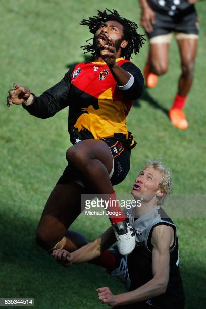 John Ikupu of Papua New Guinea leaps over Ty SMITH of New Zealand during the 2017 AFL International Cup Grand FInal match between New Zealand and...