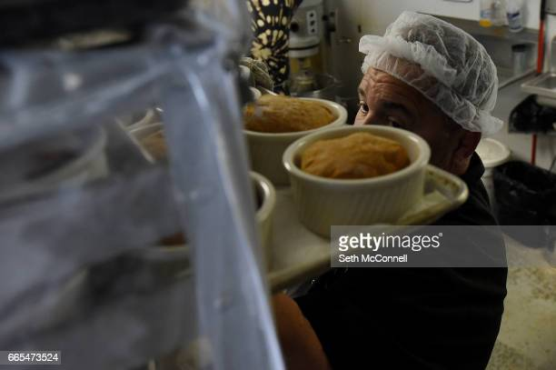 John Irvin places a tray of fresh baked hamburger buns on a rack to cool at Gluten Free Things on April 5 in Arvada Colorado Gluten Free Things is a...