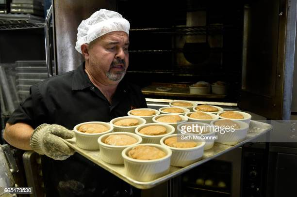 John Irvin pulls a pan of fresh baked hamburger buns from the over at Gluten Free Things on April 5 in Arvada Colorado Gluten Free Things is a...
