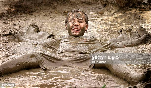 John Irwin of Livonia MIchigan makes a mud angel during the annual Mud Day event July 6 2004 in Westland Michigan The popular annual event brings...