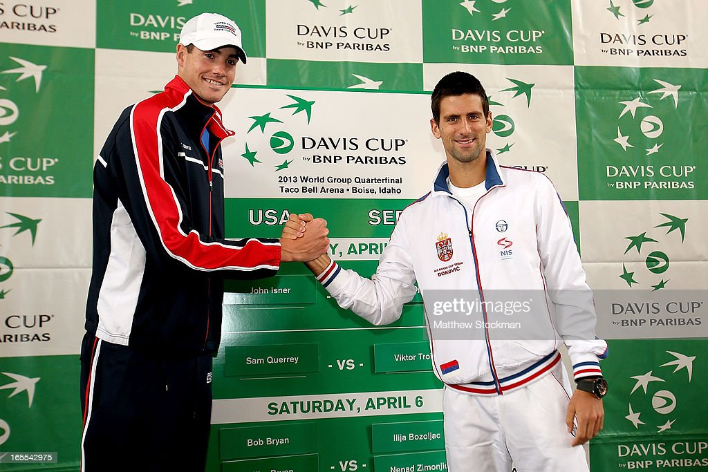 John Isner and Novak Djokovic of Serbia pose during the draw ceremony at the Boise Depot on April 4, 2013 in Boise, Idaho.