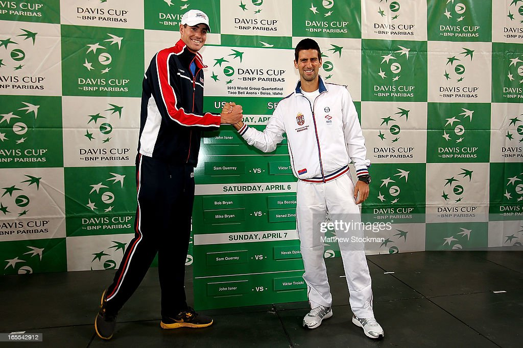 John Isner and Novak Djokovic of Serbia pose for photographers during the draw ceremony at the Boise Depot on April 4, 2013 in Boise, Idaho.