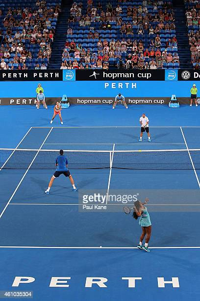 John Isner and Serena Williams of the United States contest the mixed doubles match against Flavia Pennetta and Fabio Fognini of Italy during day two...