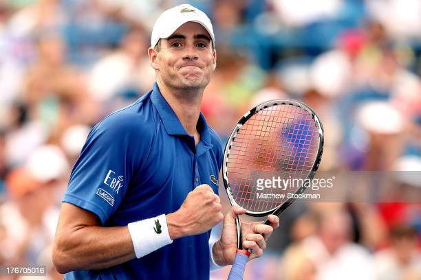 John Isner celebrates match point against Juan Martin Del Potro of Argentina during the semifinals of the Western Southern Open on August 17 2013 at...