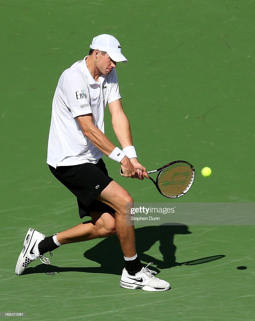 John Isner hits a return to Lleyton Hewitt of Australia during day 4 of the BNP Paribas Open at Indian Wells Tennis Garden on March 9, 2013 in Indian Wells, California. Sto0sur won 6-3, 6-4.