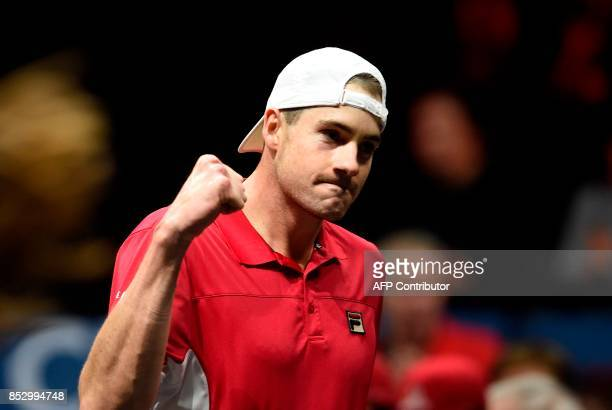 US John Isner of Team World celebrates after a match against Spanish Rafael Nadal of Team Europe during third day of Laver Cup on September 24 2017...