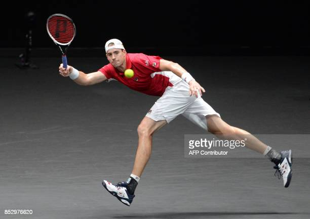 US John Isner of Team World returns a ball to Spanish Rafael Nadal of Team Europe during third day of Laver Cup on September 24 2017 in O2 Arena in...