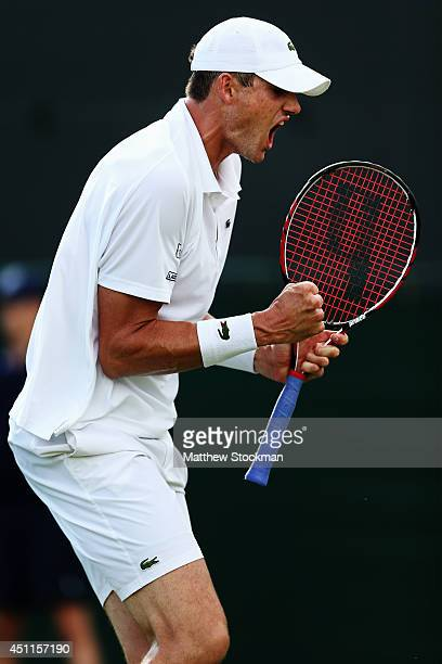 John Isner of the United States celebrates after winning his Gentlemen's Singles first round match against Daniel Smethurst of Great Britain on day...