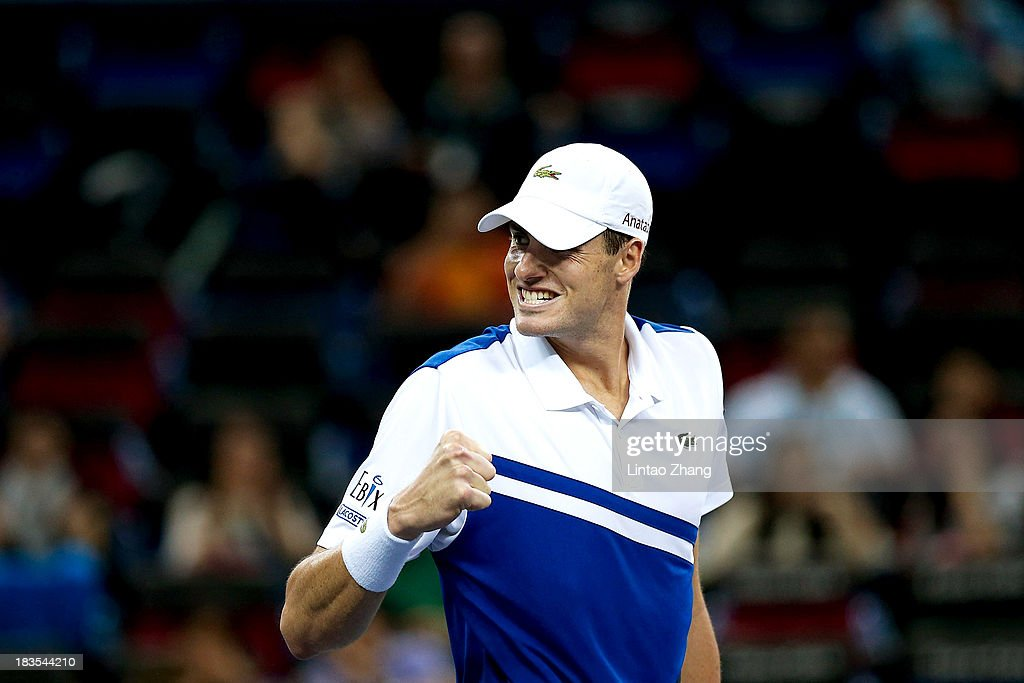 <a gi-track='captionPersonalityLinkClicked' href=/galleries/search?phrase=John+Isner+-+Tennis+Player&family=editorial&specificpeople=4439464 ng-click='$event.stopPropagation()'>John Isner</a> of the United States celebrates winning against Santiago Giraldo of Columbia during day one of the Shanghai Rolex Masters at the Qi Zhong Tennis Center on October 7, 2013 in Shanghai, China.