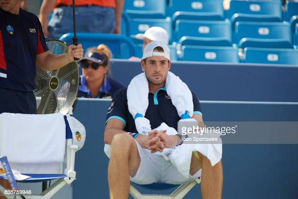 John Isner of the United States focuses between sets during a semifinal match against Grigor Dimitrov of Bulgaria in the Western Southern Open at the...