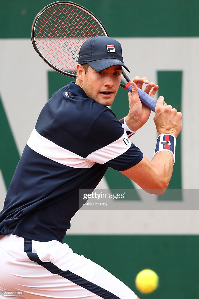 John Isner of the United States hits a backhand during the Men's Singles fourth round match against Andy Murray of Great Britain on day eight of the 2016 French Open at Roland Garros on May 29, 2016 in Paris, France.