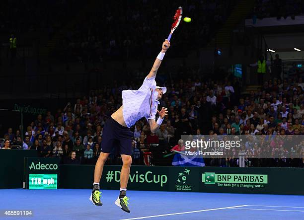 John Isner of the United States in action against Andy Murray of the Aegon GB Davis Cup Team during Day 3 of the Davis Cup match between GB and USA...