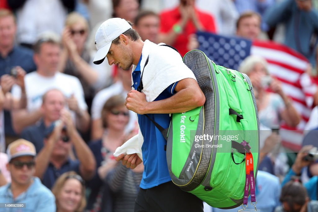 <a gi-track='captionPersonalityLinkClicked' href=/galleries/search?phrase=John+Isner+-+Tennis+Player&family=editorial&specificpeople=4439464 ng-click='$event.stopPropagation()'>John Isner</a> of the United States looks on after losing to Roger Federer of Switzerland in the Quarterfinal of Men's Singles Tennis on Day 6 of the London 2012 Olympic Games at Wimbledon on August 2, 2012 in London, England.