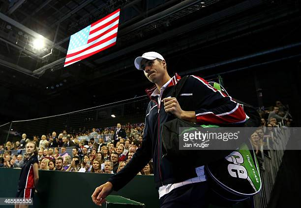 John Isner of the United States makes his way onto court during Day 3 of the Davis Cup Match between GB and USA at Emirates Arena on March 8 2015 in...