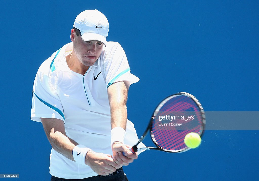 John Isner of the United States of America plays a backhand in his first round match against Dominik Hrbaty of Slovakia during day one of the 2009 Australian Open at Melbourne Park on January 19, 2009 in Melbourne, Australia.