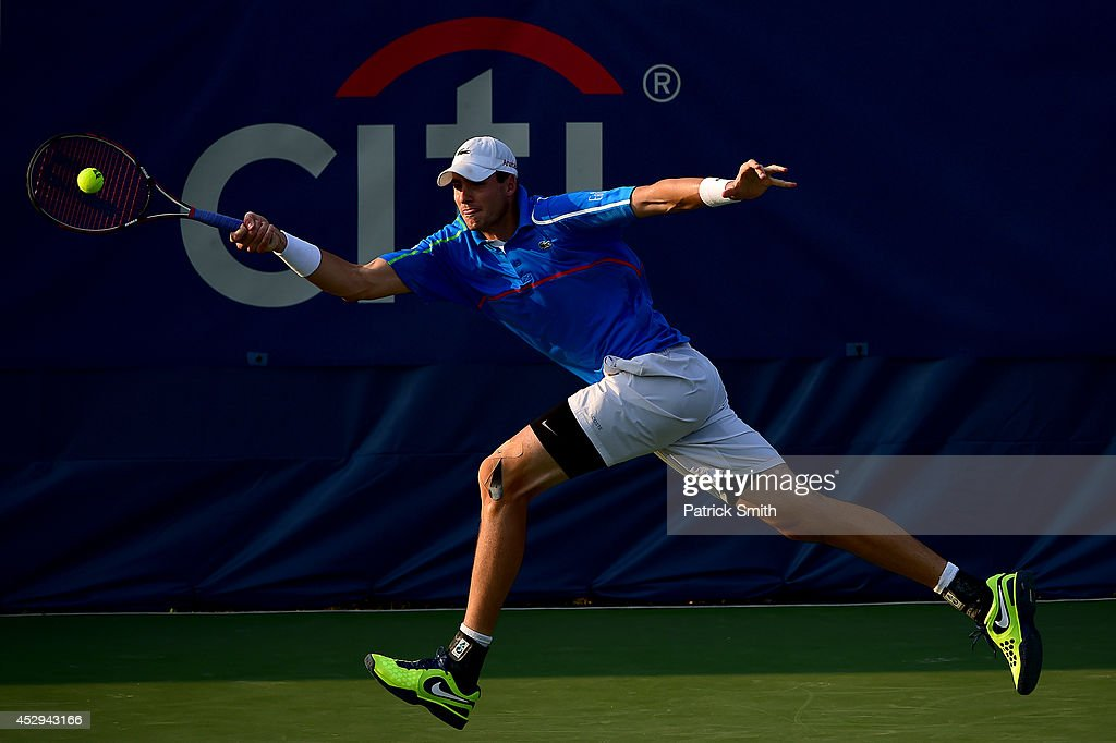 <a gi-track='captionPersonalityLinkClicked' href=/galleries/search?phrase=John+Isner+-+Tennis+Player&family=editorial&specificpeople=4439464 ng-click='$event.stopPropagation()'>John Isner</a> of the United States returns a shot to Steve Johnson of the United States during Day 3 of the Citi Open at the William H.G. FitzGerald Tennis Center on July 30, 2014 in Washington, DC.