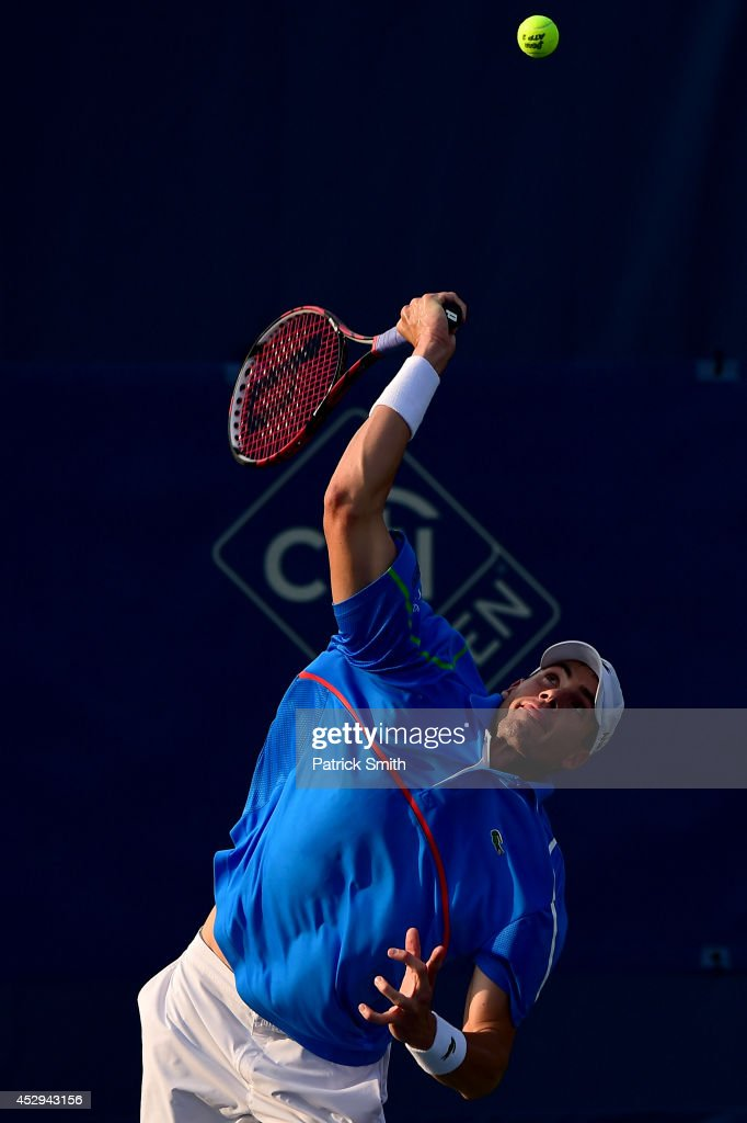 <a gi-track='captionPersonalityLinkClicked' href=/galleries/search?phrase=John+Isner+-+Tennis+Player&family=editorial&specificpeople=4439464 ng-click='$event.stopPropagation()'>John Isner</a> of the United States serves a shot to Steve Johnson of the United States during Day 3 of the Citi Open at the William H.G. FitzGerald Tennis Center on July 30, 2014 in Washington, DC.