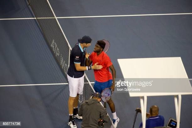 John Isner of the United States shakes hands with Frances Tiafoe of the United States after their match in the Western Southern Open at the Lindner...