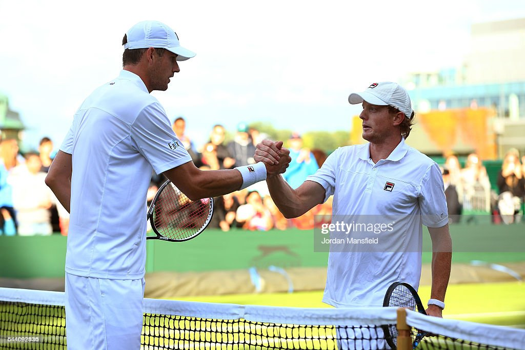 <a gi-track='captionPersonalityLinkClicked' href=/galleries/search?phrase=John+Isner+-+Tennis+Player&family=editorial&specificpeople=4439464 ng-click='$event.stopPropagation()'>John Isner</a> of The United States shakes hands with Matthew Barton of Australia in the Men's Singles second round match on day five of the Wimbledon Lawn Tennis Championships at the All England Lawn Tennis and Croquet Club on July 1, 2016 in London, England.