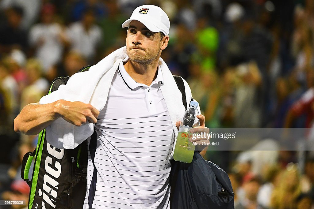 John Isner of the United States walks off the court after being defeated by Kyle Edmund of Great Britain during his third round Men's Singles match on Day Five of the 2016 US Open at the USTA Billie Jean King National Tennis Center on September 2, 2016 in the Flushing neighborhood of the Queens borough of New York City.