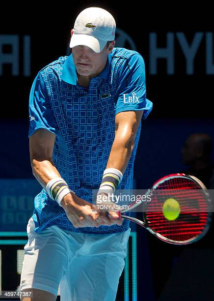 John Isner of the US hits a return against Daniel MunozDe La Nava of Spain during their fifth session men's singles match on day three of the Hopman...