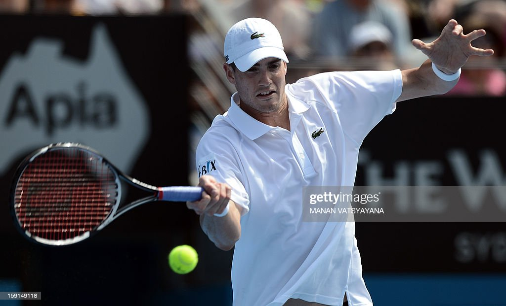 John Isner of the US returns a shot against compatriot Ryan Harrison during their match at the Sydney International tennis tournament on January 9, 2013. AFP PHOTO / MANAN VATSYAYANA USE