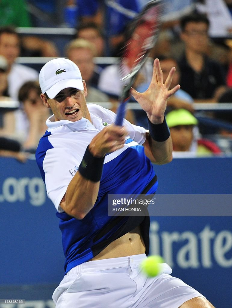 John Isner of the US returns a shot to Gael Monfils of France during their 2013 US Open men's singles match at the USTA Billie Jean King National Tennis Center August 29, 2013 in New York. AFP PHOTO/Stan HONDA