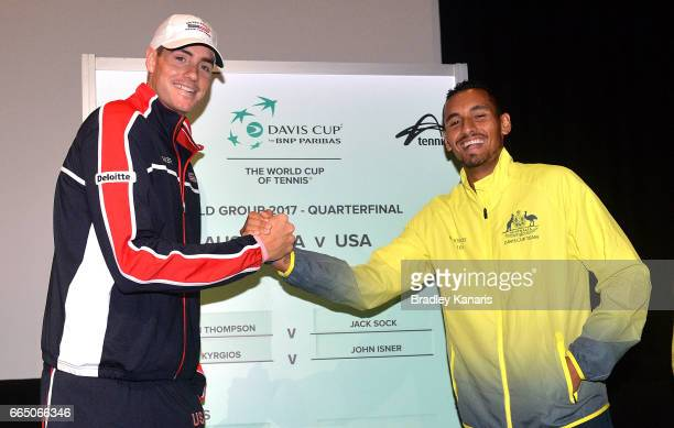 John Isner of the USA and Nick Kyrgios of Australia shake hands at the official draw for the Davis Cup World Group Quarterfinals between Australia...