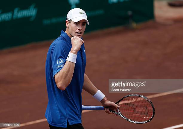 John Isner of the USA celebrates a point against Nicolas Almagro of Spain during their finals match at the US Men's Clay Court Championships at River...