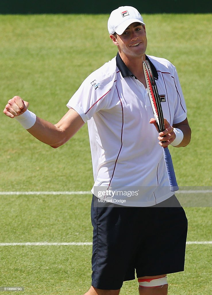 John Isner of the USA celebrates winning match point in his match against Bernard Tomic of Australia during the Davis Cup tie between Australia and the United States at Kooyong on March 6, 2016 in Melbourne, Australia.
