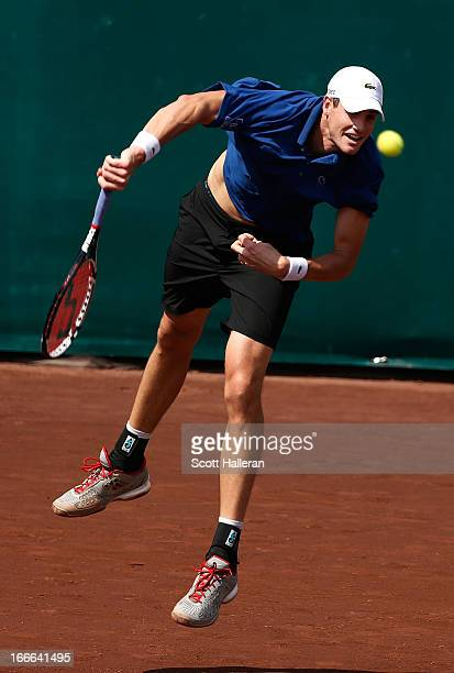 John Isner of the USA hits a serve against Nicolas Almagro of Spain during their finals match at the US Men's Clay Court Championships at River Oaks...