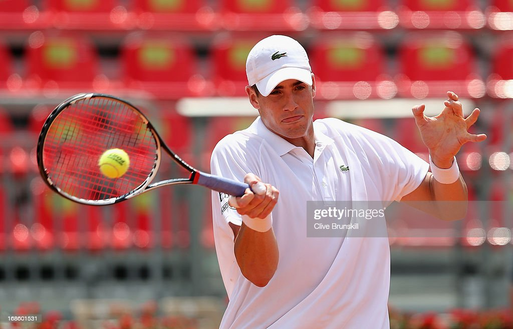 John Isner of the USA plays a forehand against Denis Istomin of Uzbekistan in their first round match during day one of the Internazionali BNL d'Italia 2013 at the Foro Italico Tennis Centre on May 12, 2013 in Rome, Italy.