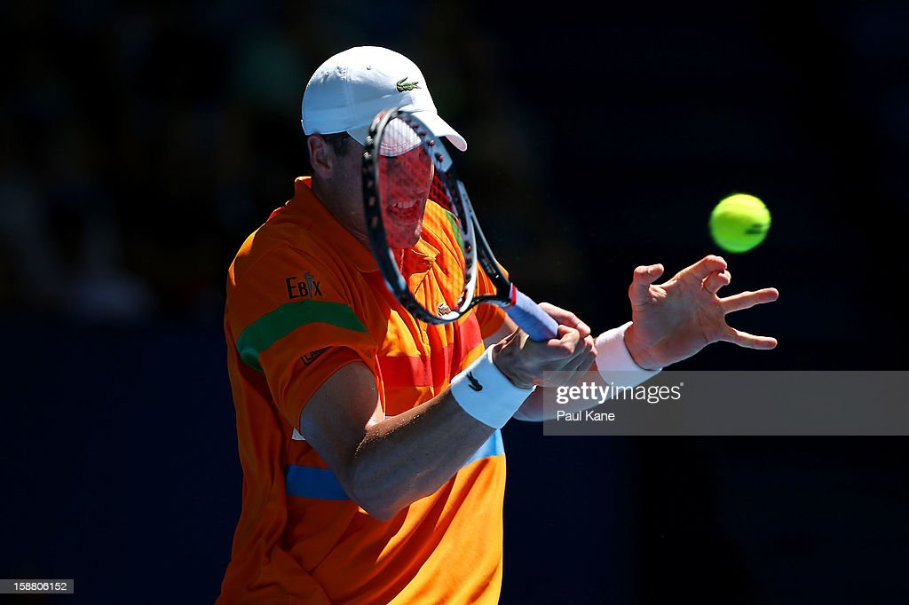 John Isner of the USA plays a forehand in his singles match against Kevin Anderson of South Africa during day two of the Hopman Cup at Perth Arena on December 30, 2012 in Perth, Australia.
