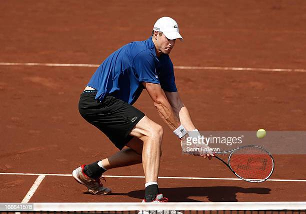 John Isner of the USA returns a shot against Nicolas Almagro of Spain during their finals match at the US Men's Clay Court Championships at River...