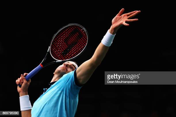 John Isner of the USA serves against Juan Martin del Potro of Argentina during Day 5 of the Rolex Paris Masters held at the AccorHotels Arena on...