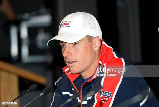 John Isner of the USA speaks at the official draw for the Davis Cup World Group Quarterfinals between Australia and the USA at Pat Rafter Arena on...