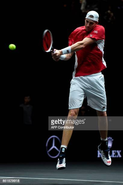 John Isner of United States and Team World returns the ball to Austrian Dominic Thiem of Team Europa during the first day of the Laver Cup on...